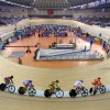 Competitors ride behind the pace-bike during the Women's Keirin final crash at the Track Cycling World Cup Classic being held at the Laoshan Velodrome in Beijing