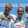 Winners Reichert, Harle and Lurz of Germany show their gold medals after the team event 5km open water race during the World Swimming Championships in Barcelona